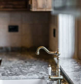 sink with industrial style pewter tap