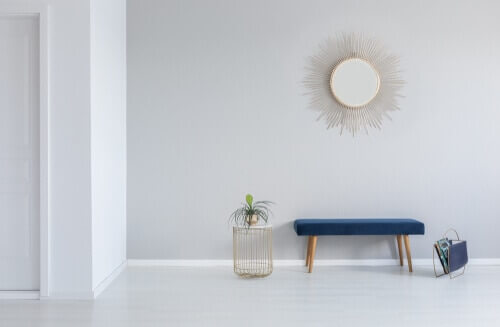 statement gold sunburst mirror over bench
