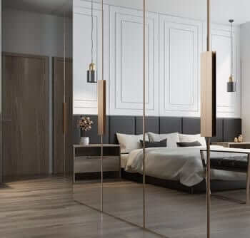 stylish bedroom with wardrobe mirrors